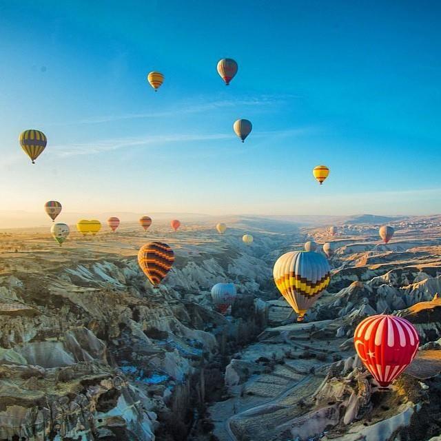 Hot air ballooning at sunrise in Cappadocia, Turkey. Photo courtesy of brianthio on Instagram.