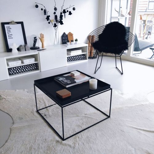 Minimal living room design with a faux sheepskin accent.