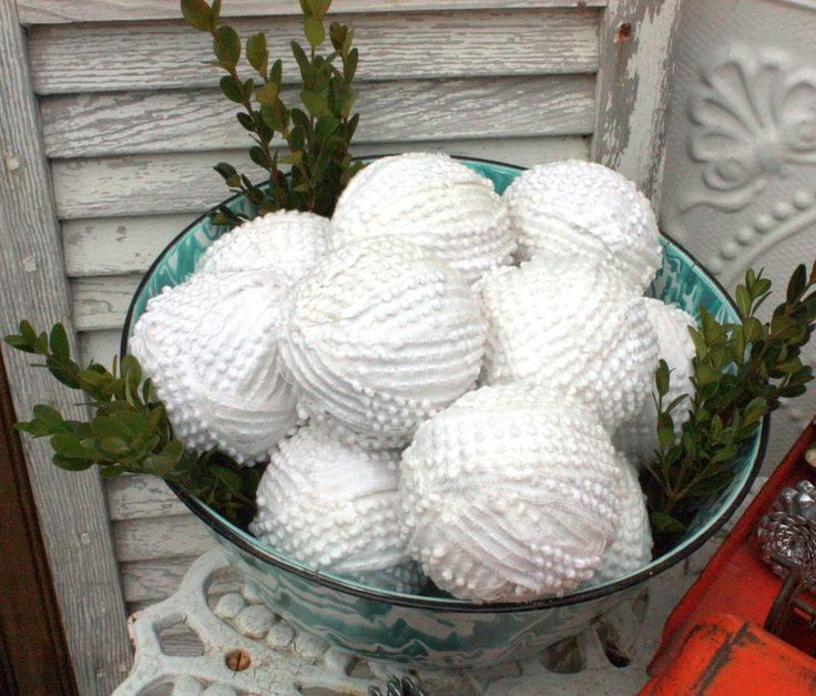 Make Snowballs from an old bedspread- These would be cute stacked in an old tin as a Christmas decoration, with a sign ...snowballs for sale.
