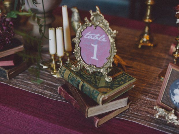 Little touches, like these vintage books provided by The Vintage Hire, will help give your #wedding its own flavour. Image © Chris Scuffins. #vintagewedding #autumnwedding #cotswoldwedding #weddingtables