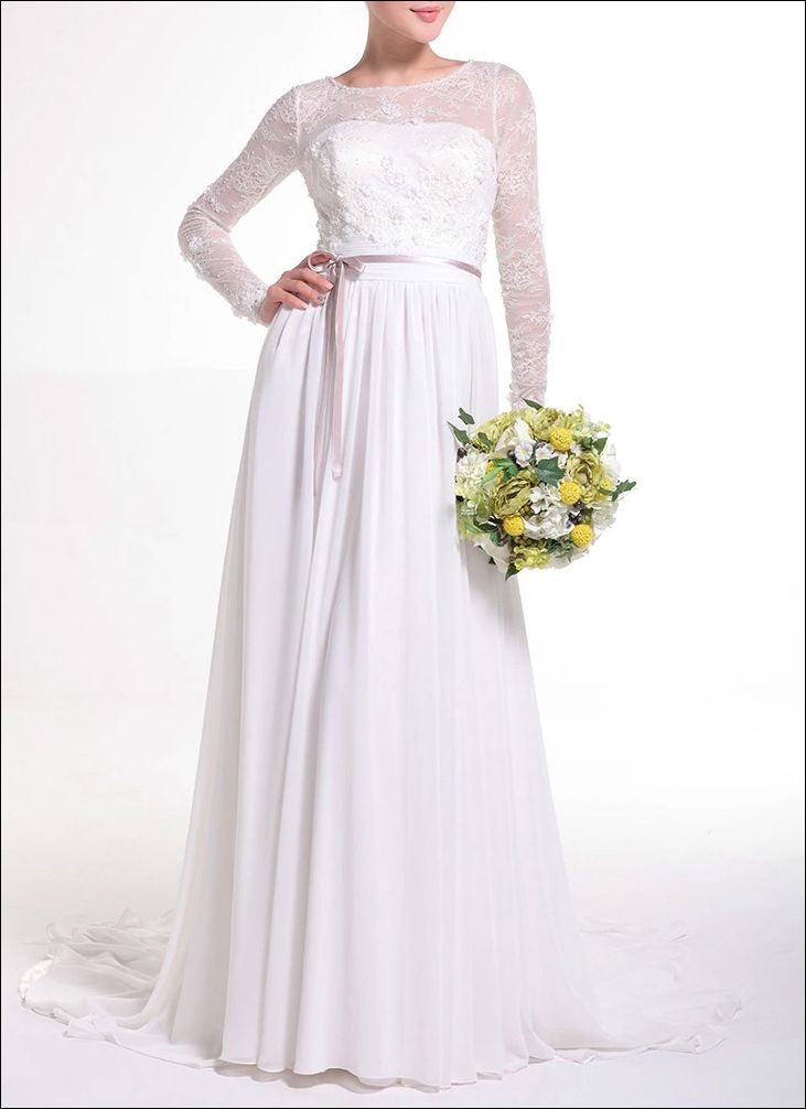 Elegantes Brautkleid mit langen Ärmeln in A- Linie, fließender Chiffonrock mit kleiner Schleppe.  Besonderer Hingucker Rückenfrei mit Schnürung für den perfekten Sitz, Oberteil mit Spitze überzogen.