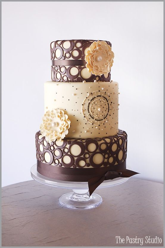 yellow and brown wedding cake. I like the center one the best, maybe with the to and bottom bring either the same yellow or white