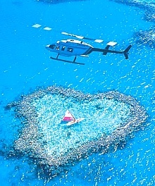 I SO want to hover over this little love heart reef in a helicopter...romance personified x