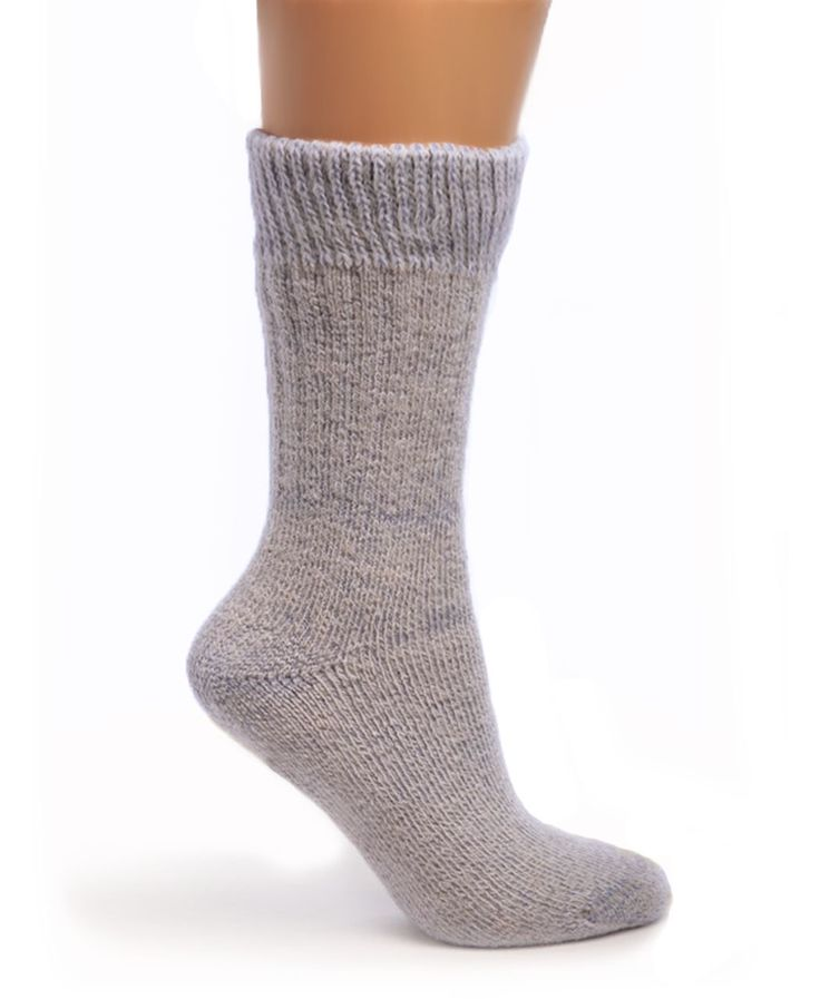 Try our thick and cozy Toasty Toes Comfort Band - Ultimate Alpaca Socks. Perfect for keeping tired cold feet toasty warm so you can relax in chilly cold weather.