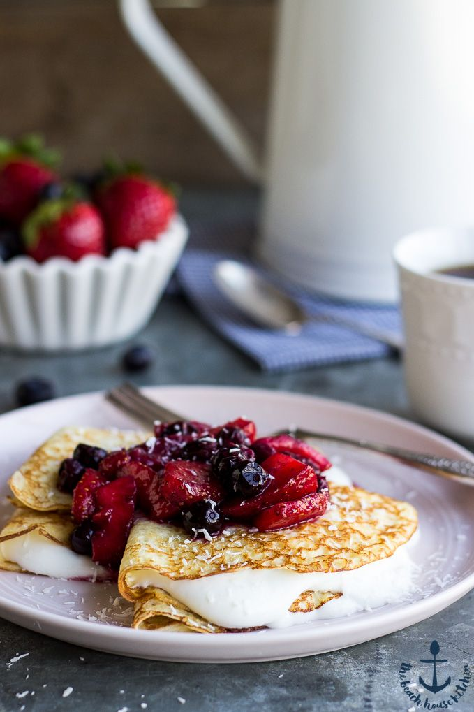 These Coconut Crepes with Whipped Greek Yogurt and Berry Compote is the perfect breakfast to welcome spring!