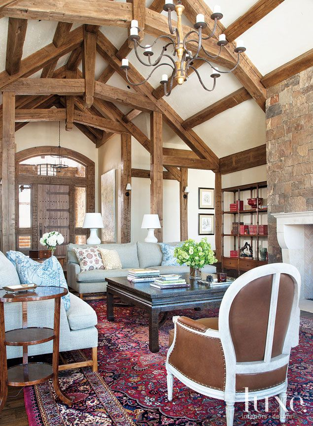 Reclaimed beams accent the #cathedral #ceiling in this #Colorado home's  #living room