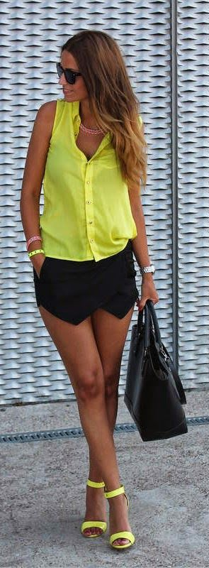 Gorgeous black skirt with bright yellow sleeveless shirt blouse and cute black leather hand bag and yellow high heels ladies sandals the best way to show fashion & style