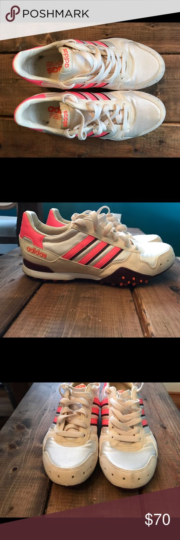 Adidas retro sneakers Off white cream color with bright salmon/coral retro adidas sneakers. Size says 7, fits more like 7.5/8. Worn only a few times! Minimal scuff on toe. Small mark on inside of heel seen in pics. In great shape!After pregnancy and child none of my shoes fit! Wish I could still wear them but have to make room for my new big hobbit feet😂 Adidas Shoes Sneakers