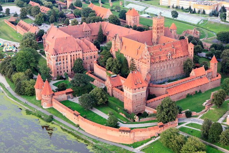 Malbork Castle in Poland is the world's largest castle. Originally a convent but then developed into an enormous fortification with towers, deep moats, strong walls, an armory and a palace for the Grand Masters. Located 18 miles southeast of Gdansk it can be reached by train or car from Gdansk.