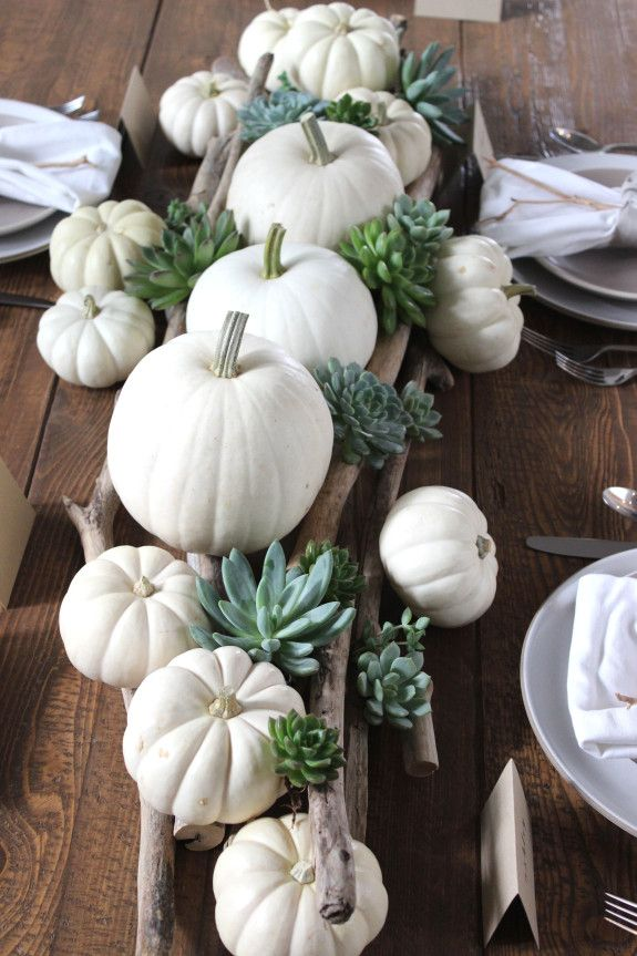 A simple tablescape for Autumn that is perfect for Thanksgiving or any other seasonal event. This table centerpiece was created using pretty wood sticks, succulents and white pumpkins.