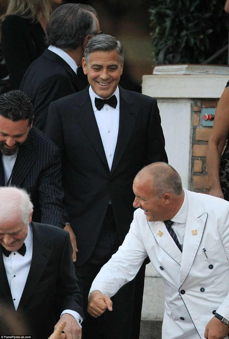 Happy face: George follows his father, Nick Clooney, onto the boat that would take them to the wedding venue #GeorgeClooney