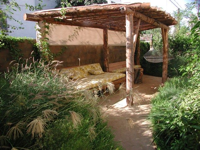 We have all those red wooden poles...  Natural Log Pergola Pergola and Patio Cover Stout Design Build Los Angeles, CA