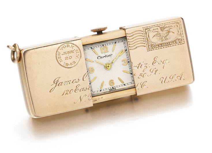 Cartier - A FINE PINK GOLD LETTER-FORM PURSE WATCH CIRCA 1943