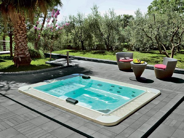 This elegant body of water, with its generous rectangular shape, offers up to 6 #massage seats at different height #minipool #outdoor