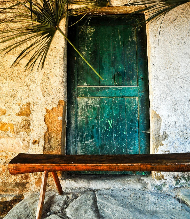 blue teal door weathered stucco bombay style stained rough cut wood
