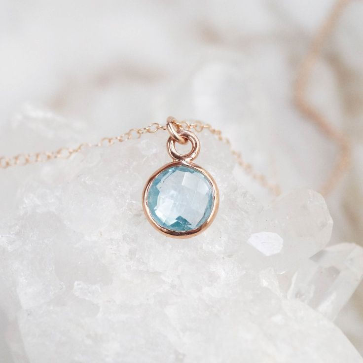 Our Blue Topaz Necklace is an absolute stunner! The genuine Blue Topaz stone hangs from high-quality rose gold-filled cable chain. The pendant is a gorgeous shade of aqua blue & it sparkles SO beautif