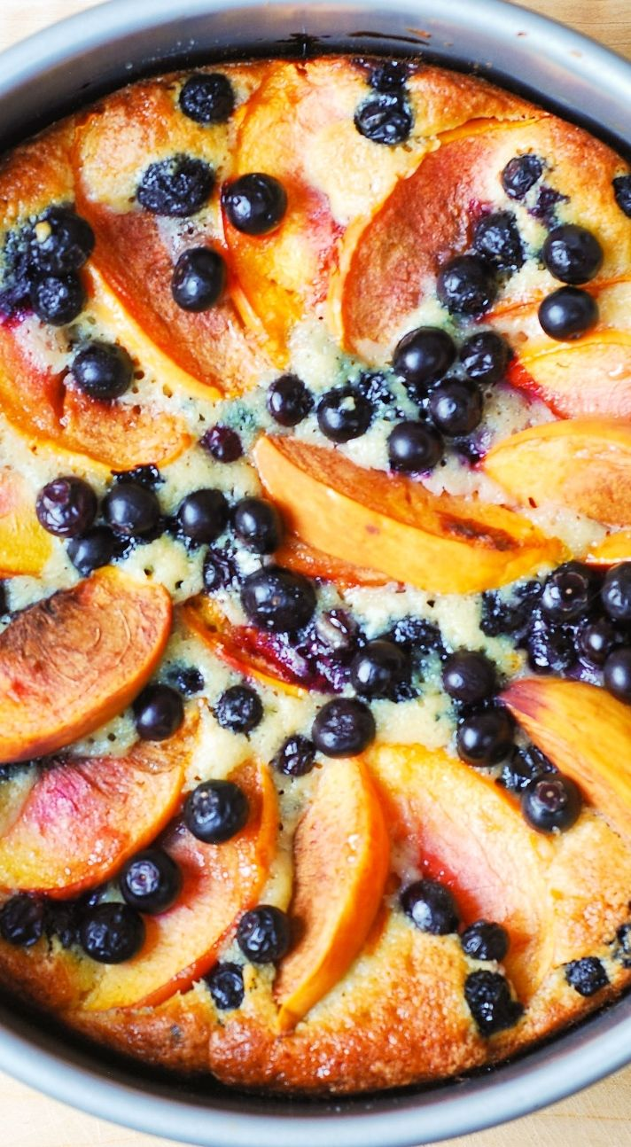 Delicious, light and fluffy Peach Blueberry Greek Yogurt Cake made in a springform baking pan. Greek yogurt gives cake a richer texture! Perfect for the Spring!