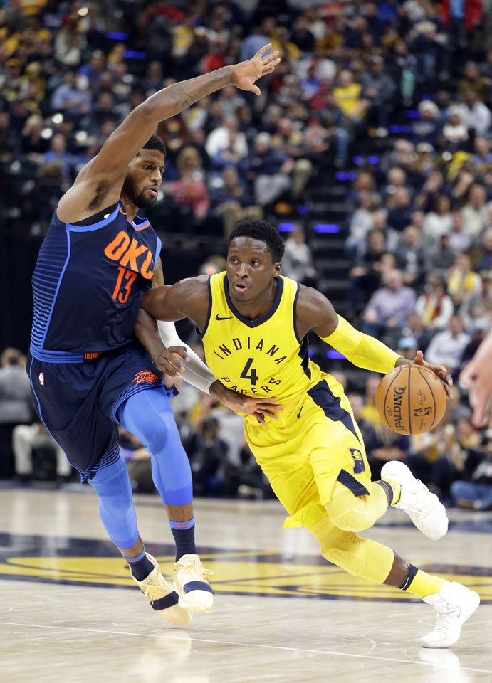 e3ca1b7ab096 Indiana Pacers guard Victor Oladipo (4) drives on Oklahoma City Thunder  forward Paul George (13) during the second half of an NBA basketball game  in ...