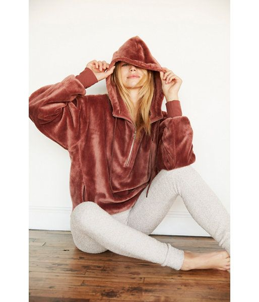 Made from amazingly plush fabric, this roomy hooded sweatshirt is as close as it gets to cozying up on a cloud. Finished with a half-zip front and pockets. We dare you not to buy one in every color.
