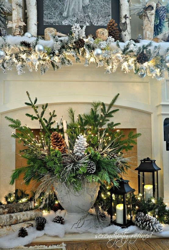 Love the simplicity of centerpiece...Urn, pinecones, twigs, lighted branches, fresh Christmas greens....Nice.