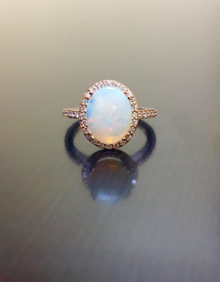 18K Rose Gold Halo Diamond Opal Engagement Ring -  Rose Gold Opal Diamond Wedding Ring - Art Deco Rose Gold Opal Ring - Halo Diamond Ring by DeKaraDesigns on Etsy https://www.etsy.com/listing/264068343/18k-rose-gold-halo-diamond-opal