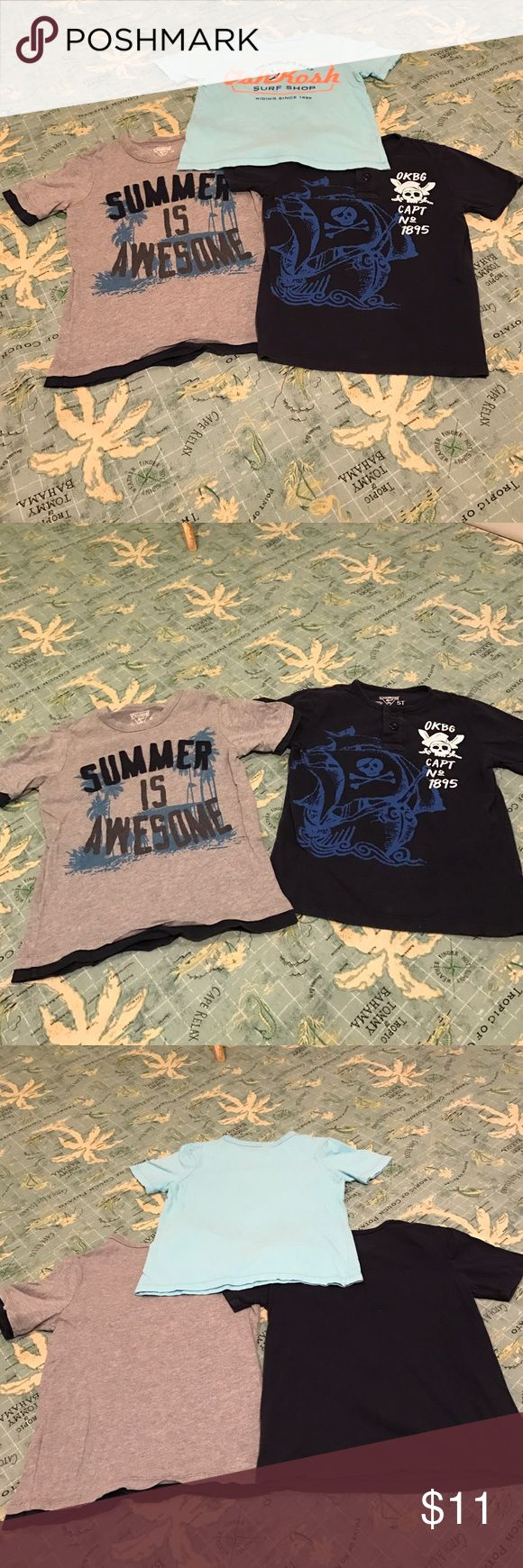 Osh Kosh Set Of 3 Shirts Cute Set Of 3 Boy's Short Sleeve Crew Neck Shirts By Osh Kosh. The navy blue with pirates & the turquoise like color that says surf shop are size: 5T. The gray & navy blue that says summer is awesome with palm trees is a size:5. All EUC. All 100% cotton. Machine wash. Tumble dry. NO TRADES. Osh Kosh Shirts & Tops Tees - Short Sleeve