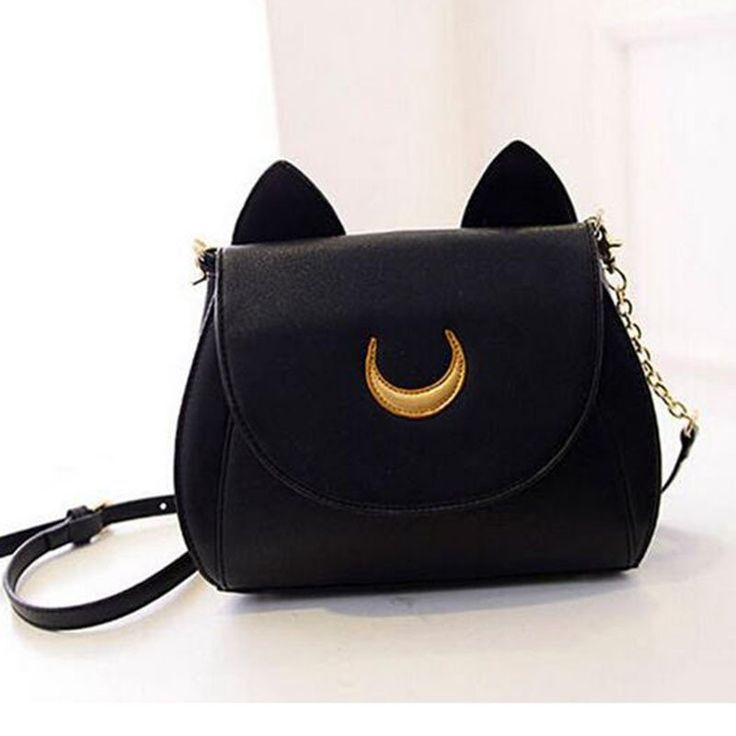 Are you a cat lover? Looking for something different? This is your bag! - Stylish and cute shoulder purse with magnetic strap closure. - Detachable and adjustable shoulder strap/chain to fit any size!