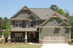 Arts and Crafts, or Craftsman , houses have many of these features:    •Wood, stone, or stucco siding  •Low-pitched roof  •Wide eaves with ...