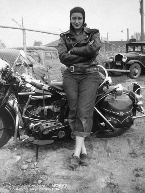 1940to1949: A woman poses in her black leather jacket1949. The Harley-Davidson MuseumJohn McDermott