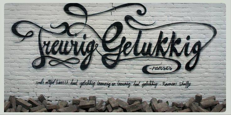 """Treurig Gelukkig. Muurschildering in honour of/ ter ere van Ramses shaffy. Gemaakt door Lj vanT ( LjvanTuinen ) in Leeuwarden. """"Zoals altijd ben ik heel gelukkig treurig en treurig heel gelukkig"""". 2014"""
