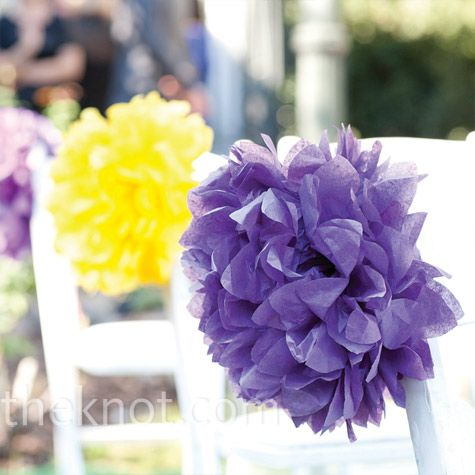 Tissue Paper Decor    The bride added bursts of purple and yellow to the wedding aisle with large tissue paper pompoms.