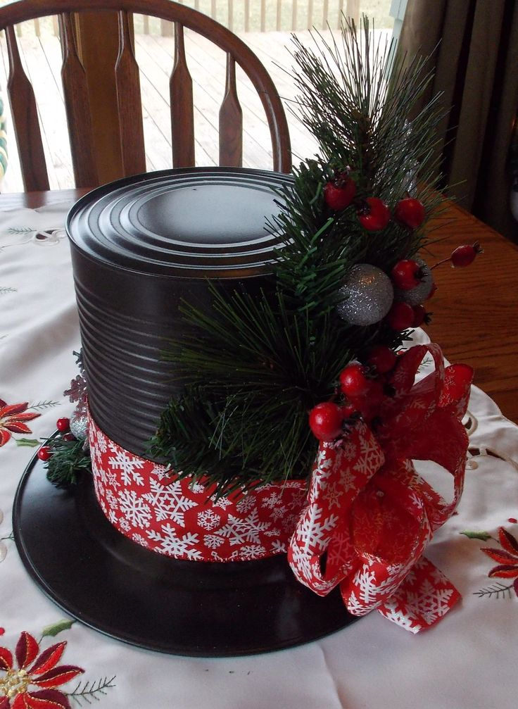 Snowman hat centerpieces made from Dollar Store plates and large tin cans