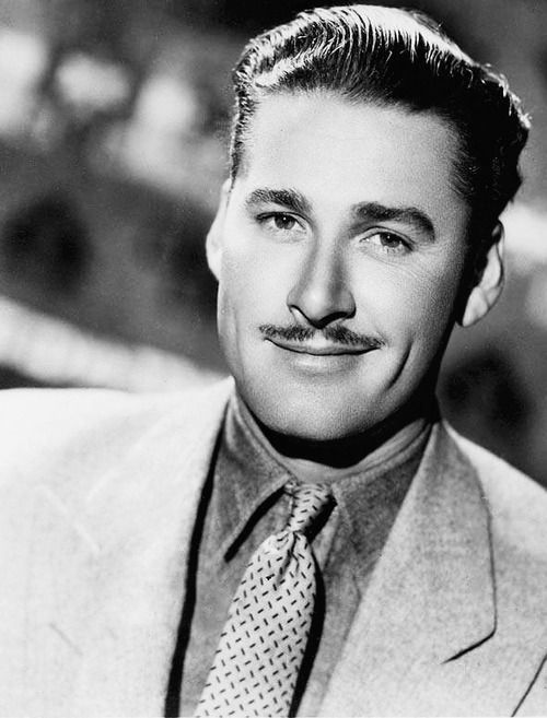 Simon and his mustache Errol Flynn, 1930's He was so cute wit his cookie duster mustache