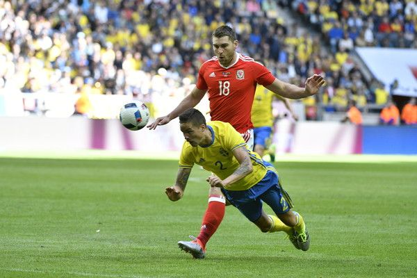 Mikael Lustig of Sweden and Sam Vokes of Wales  during the international friendly between Sweden and Wales at Friends Arena on June 5, 2016 in Solna, Sweden.
