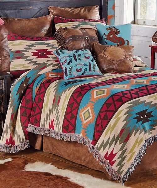 "Southwest Expressions Southwestern Bedding Woven with a classic kilim design in a vintage palette of blues, reds and greens, the cotton/poly Southwest Expressions Tapestry King Coverlet creates an inviting southwest space. Machine wash. Measures 106""W x 90""L. ~"