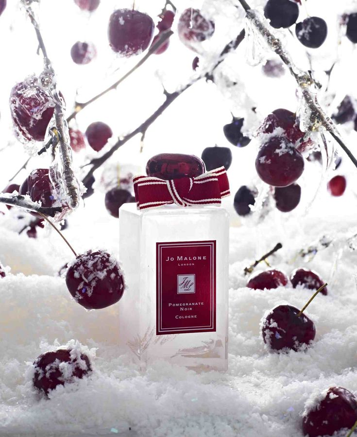 "Jo Malone Pomegranate Noir Cologne--""Ruby-rich juices of pomegranate, raspberry and plum are spiked with pink pepper and laced with Casablanca lily and spicy woods. This seductive scent is encased in a limited edition bottle, embellished with winter frost."""