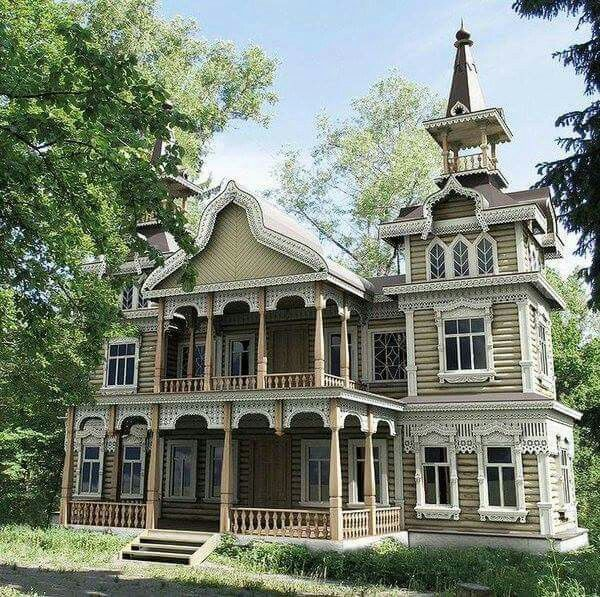 Victorian house with tower.