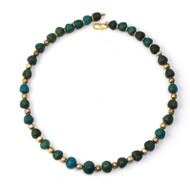 An Egyptian Gold & Ball Bead Necklace, Middle Kingdom, XII Dynasty, The Middle Kingdom is known for some of the most beautiful jewelry ever produced in ancient Egypt and this necklace is such an example.
