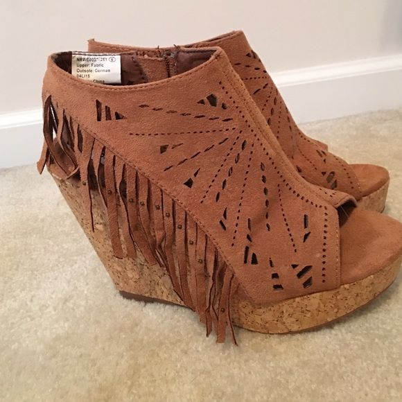 Not Rated Tan Fringe Wedge Sandals Brand new in box never worn. Tan color. Fringe detail with beads. Cut out design on suede material. Peep toe. Boho style Not Rated Shoes Wedges