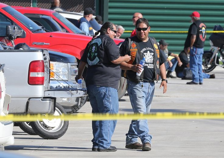 Authorities investigate a shooting in the parking lot of the Twin Peaks restaurant Sunday, May 17, 2015, in Waco, Texas. Authorities say that the shootout victims were members of rival biker gangs that had gathered for a meeting. (AP Photo/Jerry Larson)