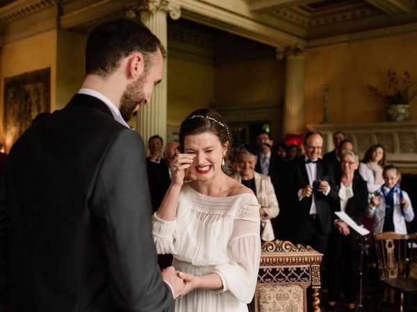Bride wiping away tear of happiness during wedding ceremony - Picture by John Barwood Photography