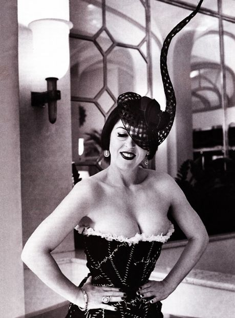 ISABELLA BLOW wearing a gorgeous corset and horn hat