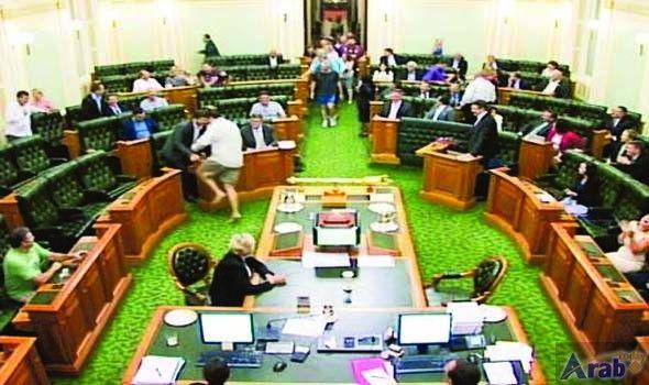 Shoeless, shirtless, breathless, Australian lawmakers still vote
