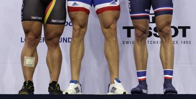 The legs of Team Britain Cyclist and Gold medalist Chris Hoy (C), German Cyclist and Silver medalist Rene Enders (L) and French Cyclist and Bronze medalist Mickael Bourgain are seen after the Mens Keirin at the UCI Track Cycling World Cup at the Olympic Velodrome in London February 18, 2012. REUTERS/Cathal McNaughton