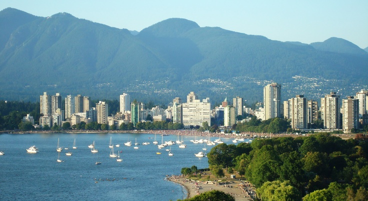 A view of English Bay Beach and the North Shore Mountains. Vancouver, BC  www.rentersguide.com