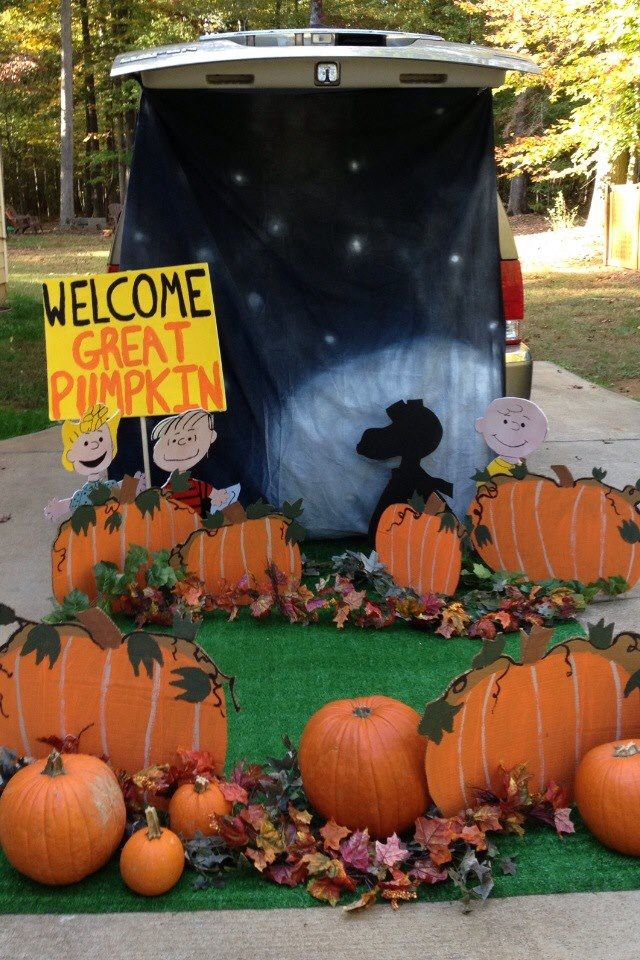 My trunk for Trunk or Treat last year.  It's a good idea for every year!  Kids get to walk through the pumpkin patch and get candy; or even stop and have their pictures taken with the Peanuts Gang.