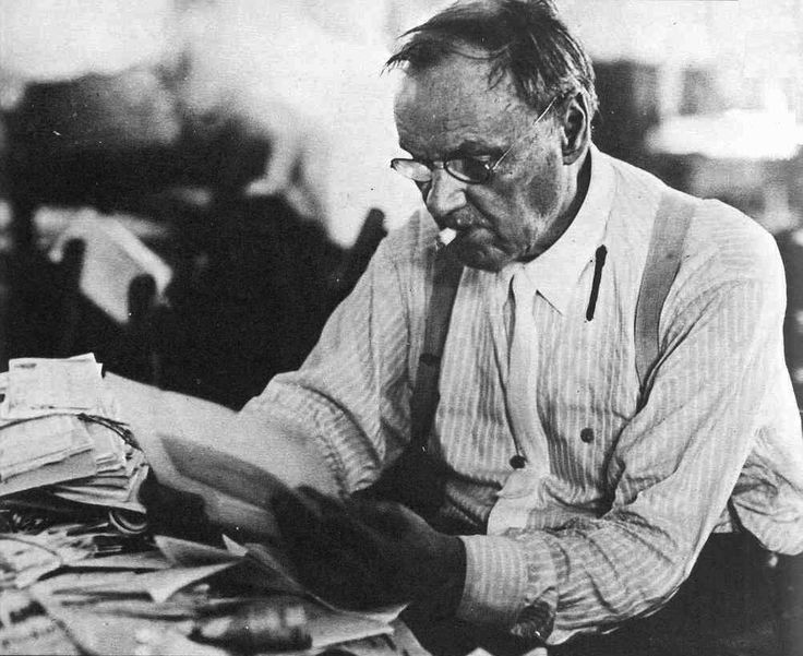 Clarence Darrow looking over papers during the Scopes Trial 1925 [1003x820]