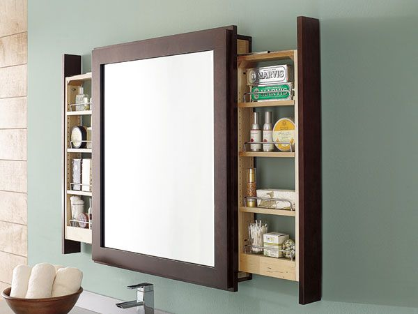 Bath mirror with pullout, by Decora Cabinetry @masterbrandinc | A novel concept for cramped baths: a medicine cabinet with shelved drawers that open to the sides
