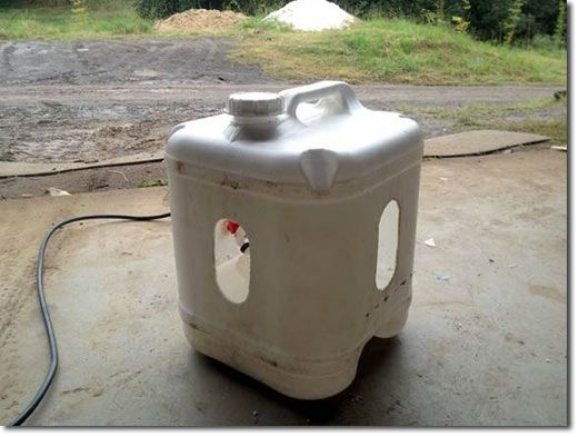 This is a head-dunking waterer for ducks that has a float valve connected to a gravity feed reservoir.  I plan to make a pool for swimming, but this is a nice option to know about.