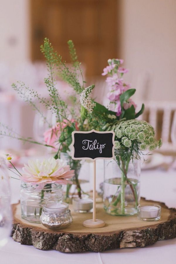 Flowers in mason jars for centrepieces